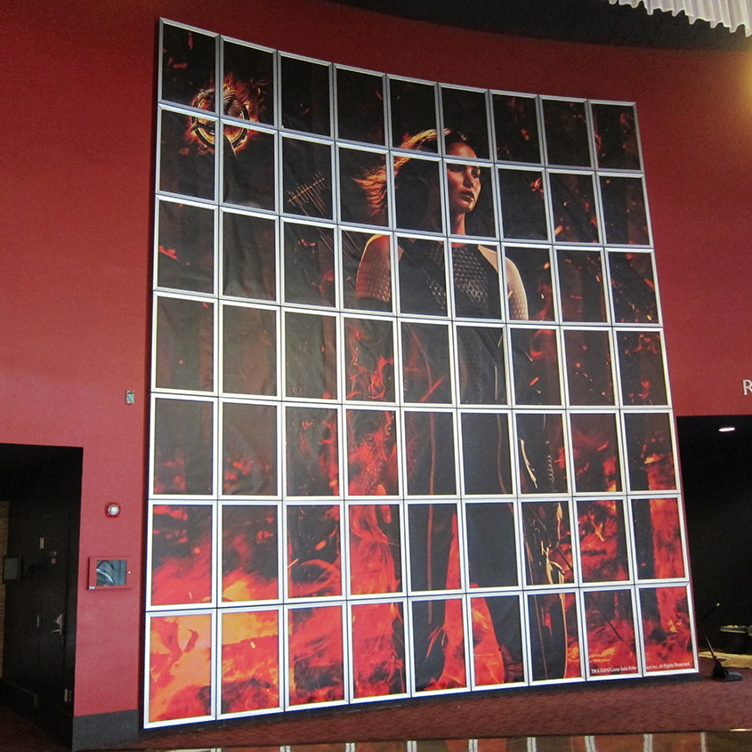 THE HUNGER GAMES:  CATCHING FIRE backlit wall at the ArcLight Beach Cities in Southern California.